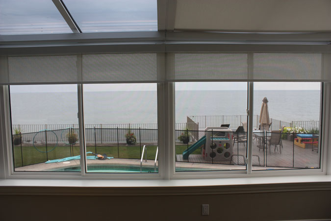 Motorized skylight blinds image galleryrose sun window for Motorized blinds for skylights